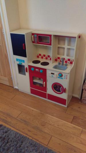Toy wooden kitchen with lots of added accessories