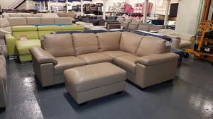 DFS Linea camel leather corner sofa and footstool