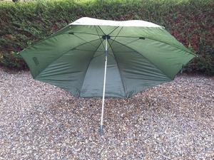Large green fishing umbrella.
