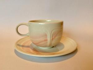 Set of five cups and saucers