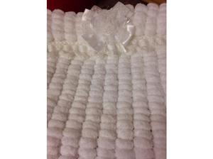 Hand knitted baby's pram cover in soft Pom Pom wool in