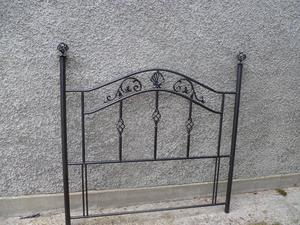 Double bed headboard. Metal with decorative features.