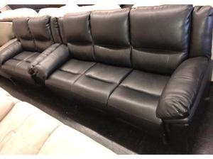 Black leather 3 + 2 seater sofa suite in Swansea