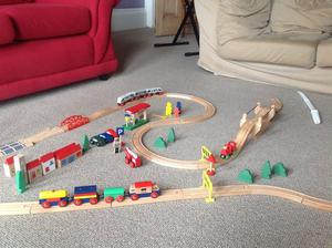 Children's wooden train set, tracks and features
