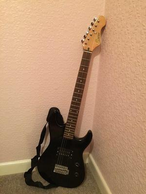 Electric Guitar:Encore E89 with black scratch plate Electric guitar and Fender 15G Frontman Amp.
