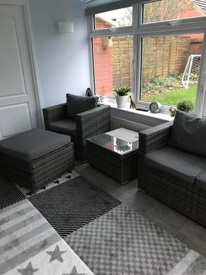 Gray rattan conservatory set complete with coffee table.