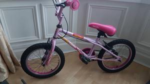 Pink child's Apollo bike
