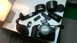 Canon EOS 10 with additional mm lens, flash, accessories, bag and manuals