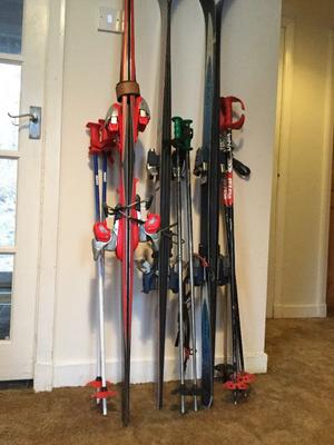 3 sets of skiis with poles