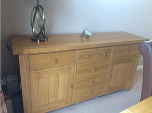 Oak dining room table, sideboard and 4 leather chairs in