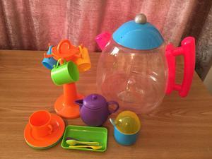 Jug of plastic cups, plates and mug tree