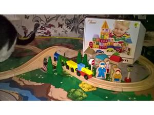 large train table with train set and city blocks in