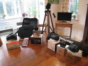Canon Camera with various lenses carry case and tri-pod all in mint condition and all with boxes