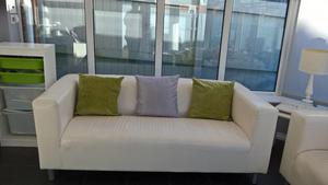Two leather effect Ikea Klippan sofas