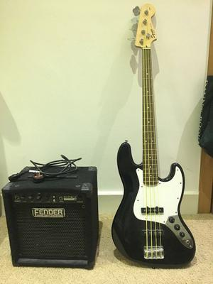 Squier by fender black jazz bass with 15watt rumble bass amp bundle