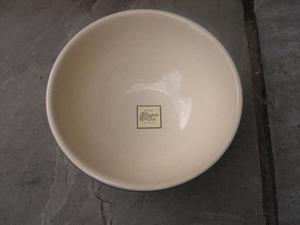 An attractive bottle green and cream Denby bowl.