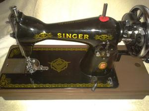 Antique Singer sewing machine with case
