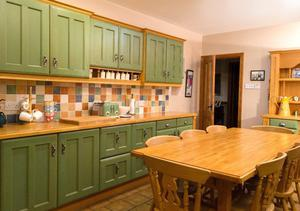 Complete Kitchen with cupboards, dresser and farmhouse table and 8 chairs