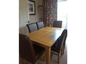 Oak dining room table and 4 leather chairs in Waterlooville