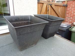 2x square decorative plastic plant pots.