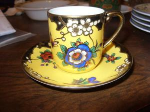 A HAND DECORATED VINTAGE CUP AND SAUCER BY NORITAKE