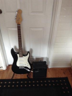 Full size electric guitar six string with amp and lead
