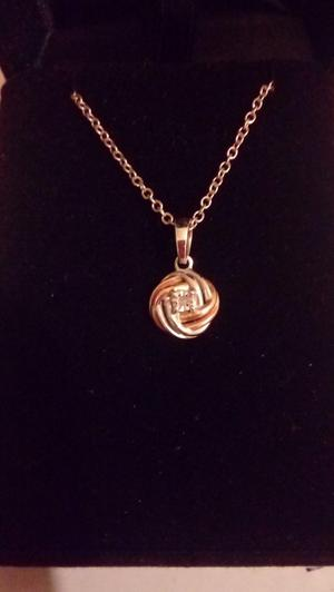 Silver and rose gold knotted pendant and chain.