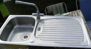 Stainless steel sink unit with mixer taps