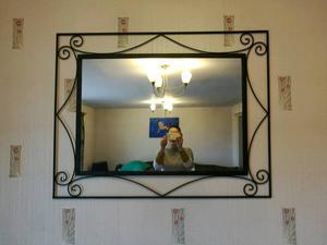 Black metal wall mirror