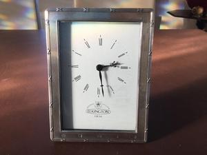 Clock in solid silver frame