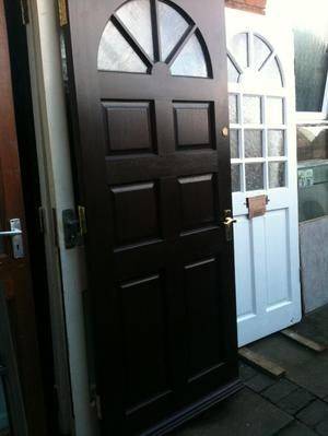 Exterior hardwood door with frosted half-circle glass