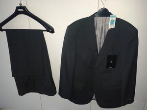 M&S Charcoal grey lined suit – jacket never worn still with tags, trousers worn once. Can separate.