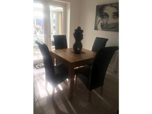 Solid oak dining room table and 4 chairs in Leicester