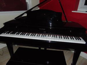 WINCHESTER ELECTRIC BABY GRAND PIANO