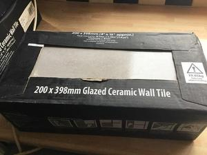 3 unopened boxes wall tiles