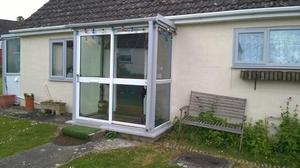 Fully double glazed porch.