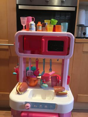 Lovely pink ELC toy kitchen and accessories.