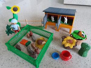Playmobil boy and rabbits with hutch