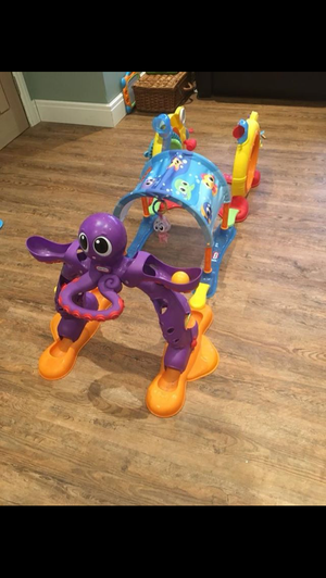 Little Tikes tunnel, fisher price table, mamas & papas rock