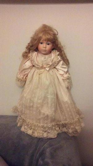 1 Full size porcelain doll& 4minature porcelain dolls