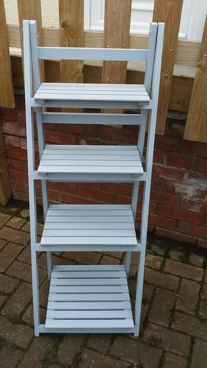 Grey wooden four shelf display stand