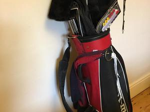 Set of golf clubs with bag.