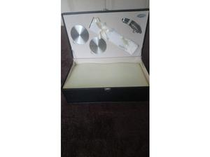 leather cased set of two crystal champagne flutes. in