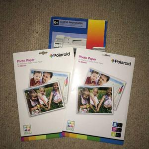 3 un-opened packs of a4 gloss photo paper
