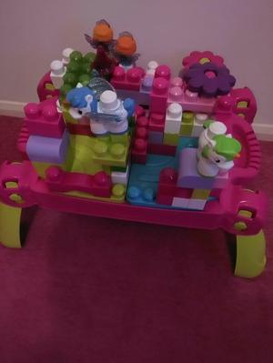 Pink mega blocks table and blocks