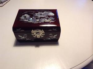 Oriental red lacquered inlaid jewellery casket.