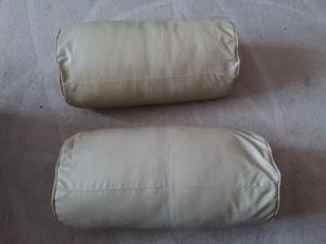 Two imitation leather beige cushions for sale.
