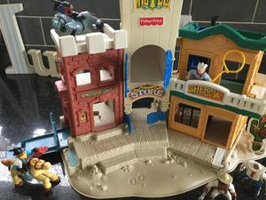 Vintage Fisher Price cowboy hotel  and several figures