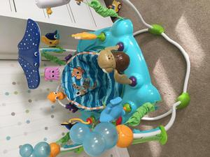We bought this a month ago for my 4 month old because she loves to stand and needed something more to entertain her than an activity mat. At first she was too small to touch the floor and couldn't reach the toys, but she quickly grew into it and now she's obsessed with jumping (though doesn't really care about the toys); this has definitely become her favorite place to be.