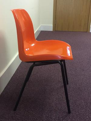 Orange Plastic and Metal Stacking Chairs